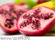 Купить «close up of ripe pomegranate and other fruits», фото № 22079372, снято 26 апреля 2015 г. (c) Syda Productions / Фотобанк Лори
