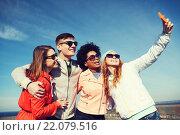 Купить «smiling friends taking selfie with smartphone», фото № 22079516, снято 19 марта 2015 г. (c) Syda Productions / Фотобанк Лори