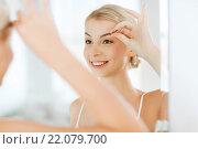 Купить «woman with tweezers tweezing eyebrow at bathroom», фото № 22079700, снято 13 февраля 2016 г. (c) Syda Productions / Фотобанк Лори