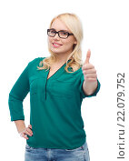 Купить «young woman in eyeglasses showing thumbs up», фото № 22079752, снято 7 февраля 2016 г. (c) Syda Productions / Фотобанк Лори