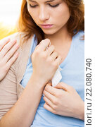 Купить «close up of crying teenage girl and friend hand», фото № 22080740, снято 12 апреля 2014 г. (c) Syda Productions / Фотобанк Лори