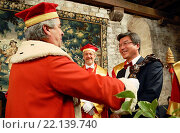 Induction of a new candidate by the Knights of Tastevin, chateau du Clos de Vougeot, Cotes d´Or, France. The Vine Stock replaces here the sword with which... Редакционное фото, фотограф Christophe Boisvieux / age Fotostock / Фотобанк Лори