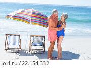 Купить «Cute mature couple hugging on the beach», фото № 22154332, снято 19 ноября 2015 г. (c) Wavebreak Media / Фотобанк Лори