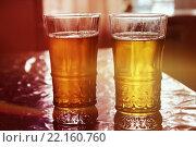 Купить «Бокалы пива с первыми лучами солнца», фото № 22160760, снято 7 марта 2016 г. (c) Андрей Лозбенев / Фотобанк Лори