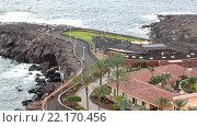 Купить «Мыс из застывшей лавы в заливе El Roque, Атлантический океан. Отель на берегу в деревне Playa Paraiso, Tenerife, Canary, Spain», видеоролик № 22170456, снято 30 января 2016 г. (c) Кекяляйнен Андрей / Фотобанк Лори