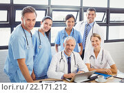 Купить «Portrait of medical team in conference room», фото № 22171212, снято 31 октября 2015 г. (c) Wavebreak Media / Фотобанк Лори