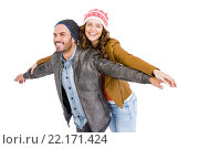 Купить «Young couple standing with arms outstretched», фото № 22171424, снято 7 октября 2015 г. (c) Wavebreak Media / Фотобанк Лори