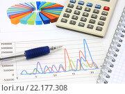 Купить «Калькулятор, графики, диаграммы и ручка. Бизнес-натюрморт», эксклюзивное фото № 22177308, снято 14 марта 2016 г. (c) Юрий Морозов / Фотобанк Лори