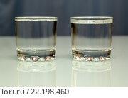 Купить «Две рюмки водки на столе», фото № 22198460, снято 19 января 2014 г. (c) Михаил Коханчиков / Фотобанк Лори