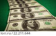 Купить «Фон из сто долларовых банкнот», видеоролик № 22211644, снято 28 января 2016 г. (c) Андрей Армягов / Фотобанк Лори