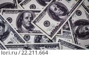 Купить «Фон из сто долларовых банкнот», видеоролик № 22211664, снято 28 января 2016 г. (c) Андрей Армягов / Фотобанк Лори
