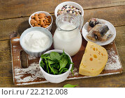 Купить «Foods Highest in Calcium on a wooden board.», фото № 22212008, снято 2 февраля 2016 г. (c) Tatjana Baibakova / Фотобанк Лори