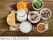 Foods Highest in Calcium on wooden background. Стоковое фото, фотограф Tatjana Baibakova / Фотобанк Лори