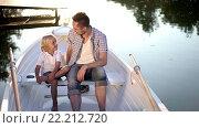 Купить «Dad and son in boat on lake», видеоролик № 22212720, снято 11 марта 2016 г. (c) Raev Denis / Фотобанк Лори