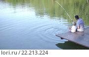 Купить «Father and son fishing in summer», видеоролик № 22213224, снято 15 марта 2016 г. (c) Raev Denis / Фотобанк Лори