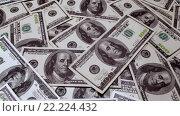 Купить «Фон из купюр по 100 долларов», видеоролик № 22224432, снято 28 января 2016 г. (c) Андрей Армягов / Фотобанк Лори