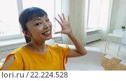 Купить «happy african american young woman at home», видеоролик № 22224528, снято 10 марта 2016 г. (c) Syda Productions / Фотобанк Лори