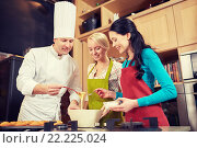 Купить «happy women and chef cook baking in kitchen», фото № 22225024, снято 12 февраля 2015 г. (c) Syda Productions / Фотобанк Лори