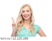 Купить «smiling young woman or teenage girl showing peace», фото № 22225288, снято 13 февраля 2016 г. (c) Syda Productions / Фотобанк Лори