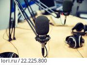 Купить «microphone at recording studio or radio station», фото № 22225800, снято 8 апреля 2015 г. (c) Syda Productions / Фотобанк Лори