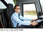 Купить «happy driver driving intercity bus», фото № 22225944, снято 21 октября 2015 г. (c) Syda Productions / Фотобанк Лори