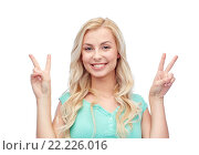 Купить «smiling young woman or teenage girl showing peace», фото № 22226016, снято 13 февраля 2016 г. (c) Syda Productions / Фотобанк Лори