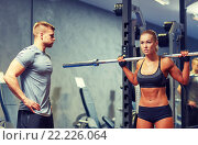 Купить «man and woman with barbell flexing muscles in gym», фото № 22226064, снято 19 апреля 2015 г. (c) Syda Productions / Фотобанк Лори