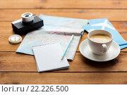Купить «close up of notepad with map and travel tickets», фото № 22226500, снято 8 февраля 2016 г. (c) Syda Productions / Фотобанк Лори