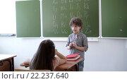 Купить «Boy at blackboard in classroom», видеоролик № 22237640, снято 16 марта 2016 г. (c) Raev Denis / Фотобанк Лори