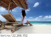 Купить «Женщина сидит в шезлонге на пляже», фото № 22266152, снято 12 марта 2016 г. (c) Иван Михайлов / Фотобанк Лори