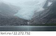 Купить «Evening Cloudy View on Lake and Glacier (Norway)», видеоролик № 22272732, снято 16 марта 2016 г. (c) Юрий Брыкайло / Фотобанк Лори