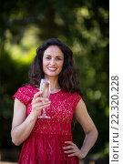 Portrait of woman holding champagne flute. Стоковое фото, агентство Wavebreak Media / Фотобанк Лори
