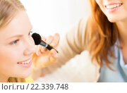 Купить «happy women with makeup brush applying blush», фото № 22339748, снято 12 апреля 2014 г. (c) Syda Productions / Фотобанк Лори