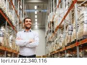 Купить «happy man at warehouse», фото № 22340116, снято 9 декабря 2015 г. (c) Syda Productions / Фотобанк Лори