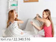 Купить «happy teen girl friends fighting pillows at home», фото № 22340516, снято 14 ноября 2015 г. (c) Syda Productions / Фотобанк Лори