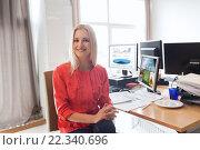 Купить «happy creative female office worker with computers», фото № 22340696, снято 29 марта 2015 г. (c) Syda Productions / Фотобанк Лори