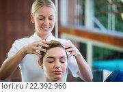 Купить «Woman receiving a head massage», фото № 22392960, снято 28 ноября 2015 г. (c) Wavebreak Media / Фотобанк Лори
