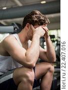 Купить «Tired man sitting on treadmill», фото № 22407016, снято 27 сентября 2015 г. (c) Wavebreak Media / Фотобанк Лори