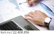 Купить «busy businessman with laptop and papers in office», видеоролик № 22408856, снято 9 июля 2015 г. (c) Syda Productions / Фотобанк Лори