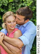 Купить «Romantic man kissing woman at front yard», фото № 22409436, снято 8 декабря 2015 г. (c) Wavebreak Media / Фотобанк Лори