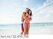 Купить «Happy couple enjoying on the beach», фото № 22410756, снято 1 декабря 2015 г. (c) Wavebreak Media / Фотобанк Лори