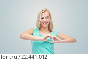 Купить «happy woman or teen girl showing heart shape sigh», фото № 22441012, снято 13 февраля 2016 г. (c) Syda Productions / Фотобанк Лори