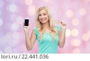 Купить «happy young woman or teenage girl with smartphone», фото № 22441036, снято 13 февраля 2016 г. (c) Syda Productions / Фотобанк Лори