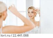 Купить «woman with tweezers tweezing eyebrow at bathroom», фото № 22441088, снято 13 февраля 2016 г. (c) Syda Productions / Фотобанк Лори
