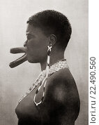 Купить «Artificial deformation. A woman of the Sara tribe, Chad, Central Africa, with artificial deformation of the lips as a sign of beauty. The effect is produced...», фото № 22490560, снято 29 мая 2020 г. (c) age Fotostock / Фотобанк Лори