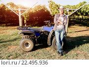 Купить «Man standing next to truck in vineyard», фото № 22495936, снято 28 марта 2015 г. (c) Sergey Nivens / Фотобанк Лори