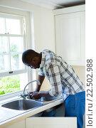 Купить «Man repairing a kitchen sink», фото № 22502988, снято 19 января 2016 г. (c) Wavebreak Media / Фотобанк Лори