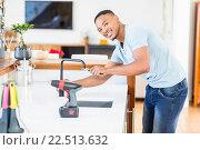 Купить «Man tightening tap with a wrench», фото № 22513632, снято 15 декабря 2015 г. (c) Wavebreak Media / Фотобанк Лори