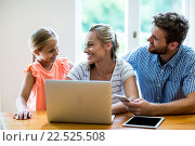Купить «Smiling parents with technologies looking at daughter», фото № 22525508, снято 26 января 2016 г. (c) Wavebreak Media / Фотобанк Лори