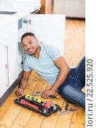 Купить «Man repairing a kitchen sink», фото № 22525920, снято 15 декабря 2015 г. (c) Wavebreak Media / Фотобанк Лори